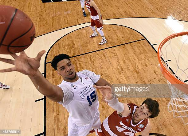 Jahlil Okafor of the Duke Blue Devils goes up with the ball against Frank Kaminsky of the Wisconsin Badgers in the first half during the NCAA Men's...