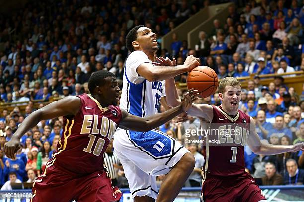 Jahlil Okafor of the Duke Blue Devils has the ball knocked away by teammates Austin Hamilton and Luke Eddy of the Elon Phoenix during their game at...