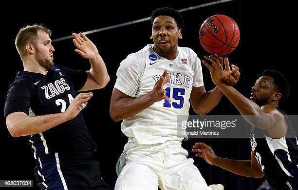 Jahlil Okafor of the Duke Blue Devils loses control of the ball as Przemek Karnowski and Byron Wesley of the Gonzaga Bulldogs defend in the first...