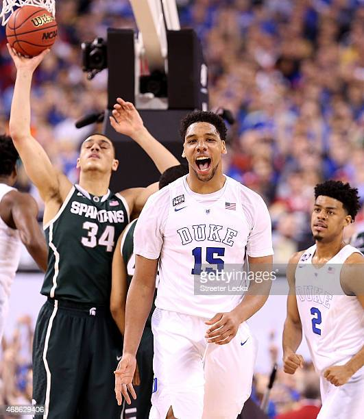 Jahlil Okafor of the Duke Blue Devils reacts after a play in the second half as Gavin Schilling of the Michigan State Spartans looks on during the...