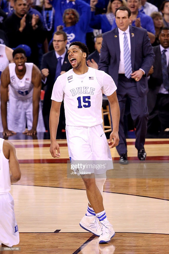 Jahlil Okafor #15 of the Duke Blue Devils reacts after a play in the second half as Mike Krzyzewski looks on against the Michigan State Spartans during the NCAA Men's Final Four Semifinal at Lucas Oil Stadium on April 4, 2015 in Indianapolis, Indiana.