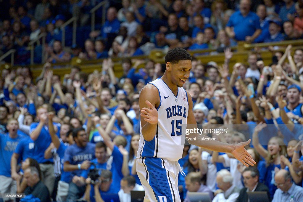 Jahlil Okafor of the Duke Blue Devils reacts after dunking against the Presbyterian Blue Hose during their game at Cameron Indoor Stadium on November...