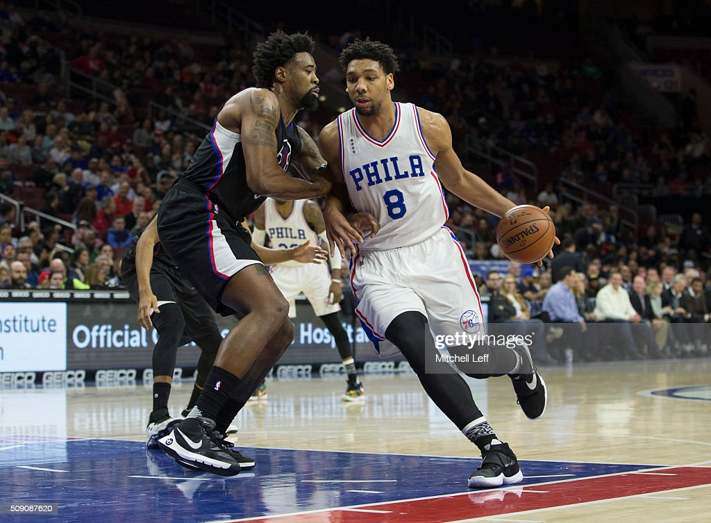Jahlil Okafor #8 of the Philadelphia 76ers controls the ball against DeAndre Jordan #6 of the Los Angeles Clippers on February 8, 2016 at the Wells Fargo Center in Philadelphia, Pennsylvania.