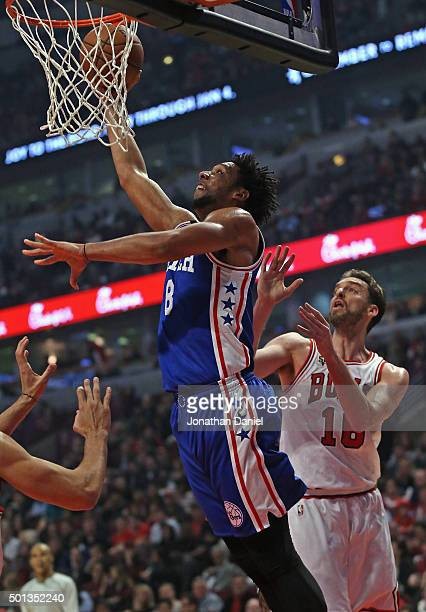 Jahlil Okafor of the Philadelphia 76ers goes up for a shot past Pau Gasol of the Chicago Bulls at the United Center on December 14 2015 in Chicago...
