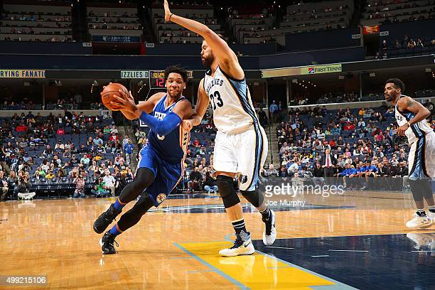 Jahlil Okafor of the Philadelphia 76ers handles the ball against Marc Gasol of the Memphis Grizzlies on November 29 2015 at FedExForum in Memphis...