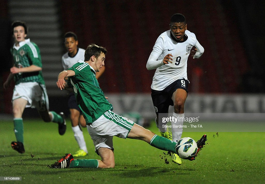 Jahmal Hector-Ingram of England U16 is tackled by Dylan King of Northern Ireland U16 during the Victory Shield match between England U16 and Northern Ireland U16 at Goldsands Stadium on November 8, 2013 in Bournemouth, England.