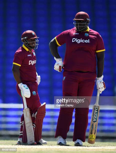 Jahmar Hamilton and Rahkeem Cornwall of WICB President's XI during the tour match between WICB President's XI and England at Warner Park on February...