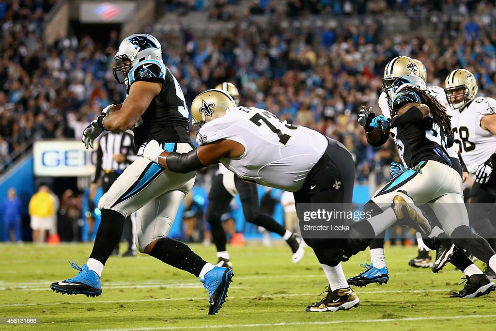 Jahri Evans of the New Orleans Saints runs down Chase Blackburn of the Carolina Panthers after his interception in the 1st quarter during their game...