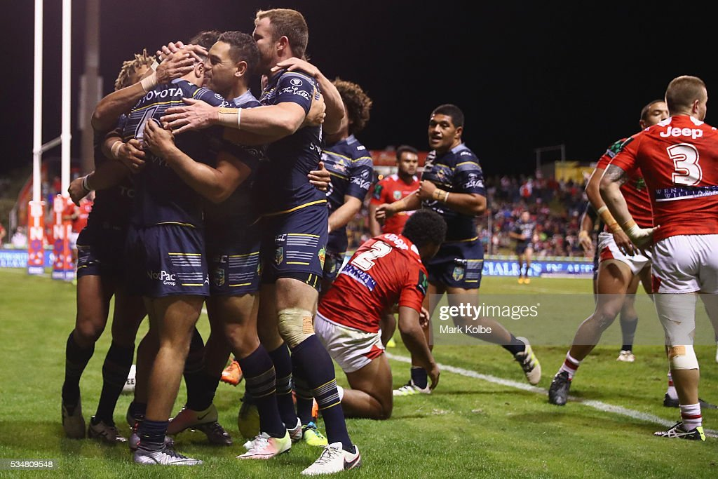 Jahrome Hughes of the Cowboys celebrates with his team mates after scoring a try during the round 12 NRL match between the St George Illawarra Dragons and the North Queensland Cowboys at WIN Jubilee Stadium on May 28, 2016 in Wollongong, Australia.