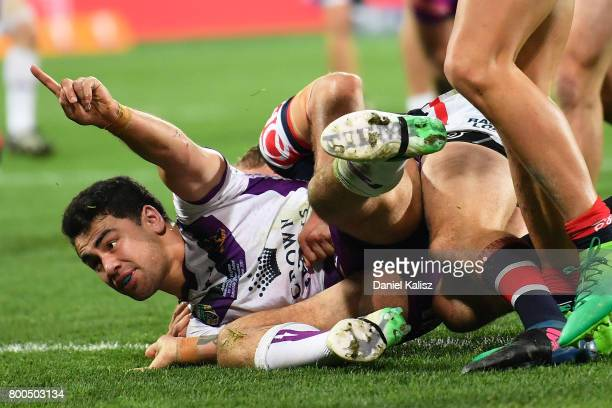 Jahrome Hughes of the Storm celebrates after scoring a try during the round 16 NRL match between the Sydney Roosters and the Melbourne Storm at...