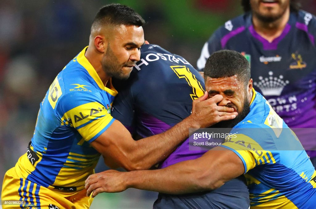 Jahrome Hughes of the Storm is tackled by Michael Jennings (R) of the Eels during the round 18 NRL match between the Melbourne Storm and the Parramatta Eels at AAMI Park on July 8, 2017 in Melbourne, Australia.