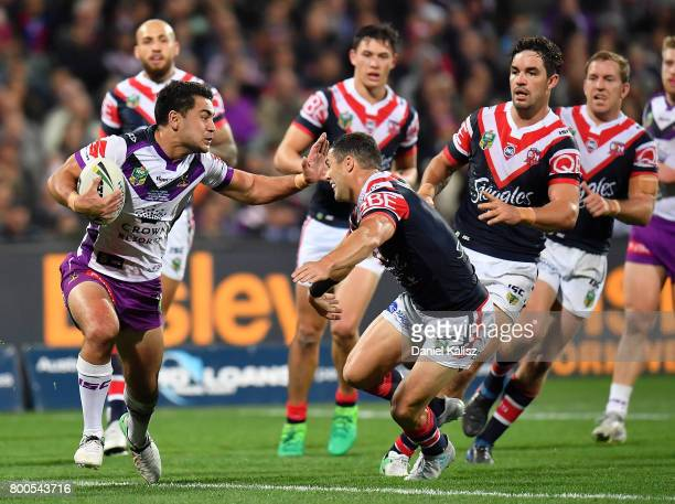 Jahrome Hughes of the Storm runs with the ball during the round 16 NRL match between the Sydney Roosters and the Melbourne Storm at Adelaide Oval on...