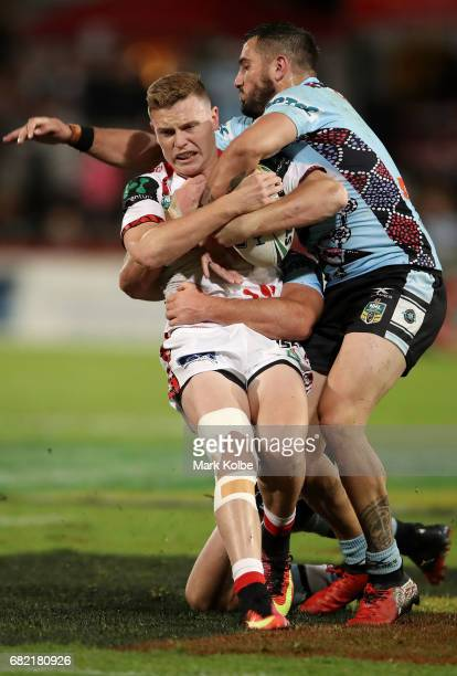 Jai Field of the Dragons is tackled by Jack Bird of the Sharks during the round 10 NRL match between the St George Illawarra Dragons and the Cronulla...
