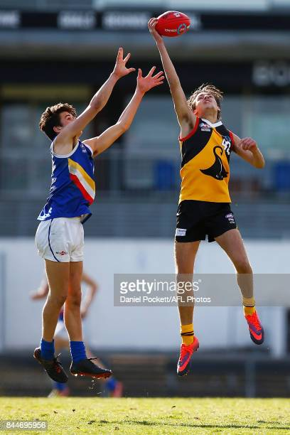 Jai Nanscawen of the Stingrays and Kye Quirk of the Ranges contest the ball during the TAC Cup Final between Dandenong and Eastern Ranges at Victoria...