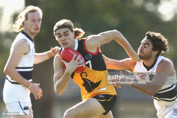 Jai Taylor of the Dandenong Stingrays is tackled during the round 13 TAC Cup match between Dandenong and Northern Knights at Shepley Oval on July 15...