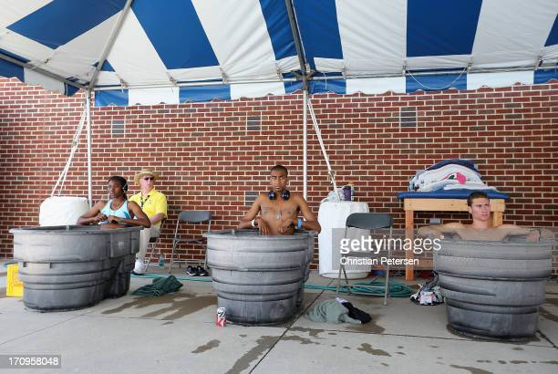 Jaide Stepter Alexander Monsivaiz and Bryce McAndrew sit in ice baths on day one of the 2013 USA Outdoor Track Field Championships at Drake Stadium...