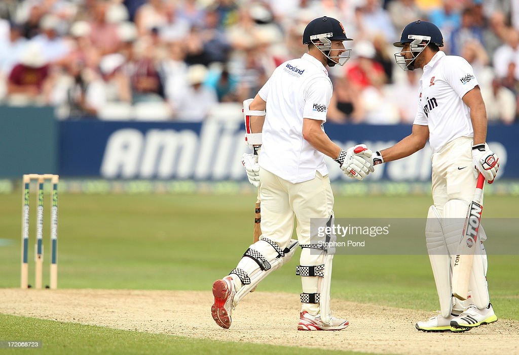 Jaik Mickleburgh of Essex (L) celebrates his half century with <a gi-track='captionPersonalityLinkClicked' href=/galleries/search?phrase=Ravi+Bopara&family=editorial&specificpeople=4106027 ng-click='$event.stopPropagation()'>Ravi Bopara</a> during day two of the Essex v England LV= Challenge match at the Ford County Ground on July 1, 2013 in Chelmsford, England.