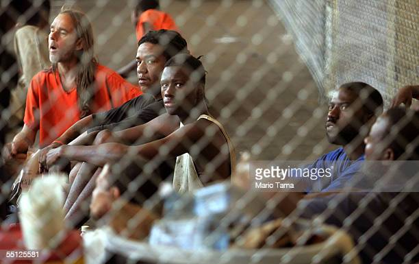 Jailed inmates sit in a temporary prison inside a Greyhound bus terminal September 6 2005 in New Orleans Louisiana About 150 inmates who were accused...