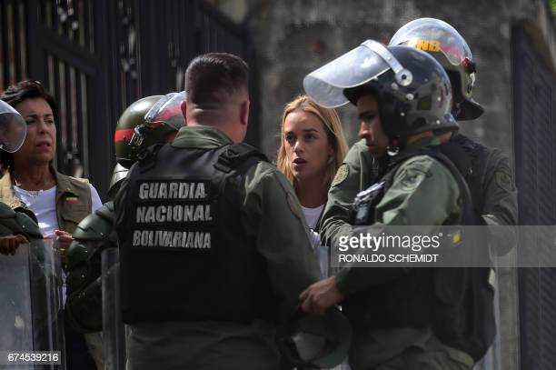 Jailed opposition leader Leopoldo Lopez's wife Lilian Tintori and mother Antonieta Mendoza de Lopez are stopped by the National Guard 500 metres from...