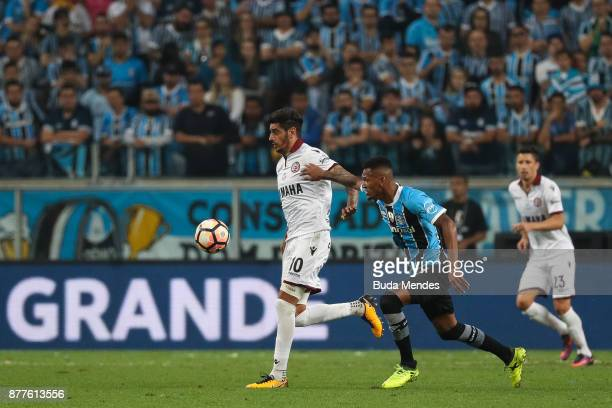 Jailson of Gremio struggles for the ball with Roman Martinez of Lanus during a first leg match between Gremio and Lanus as part of Copa Bridgestone...