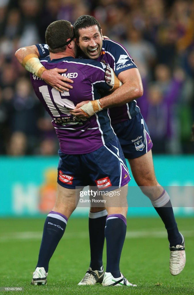 Jaiman Lowe and Bryan Norrie of the Storm celebrate winning the NRL Preliminary Final match between the Melbourne Storm and the Manly Sea Eagles at AAMI Park on September 21, 2012 in Melbourne, Australia.