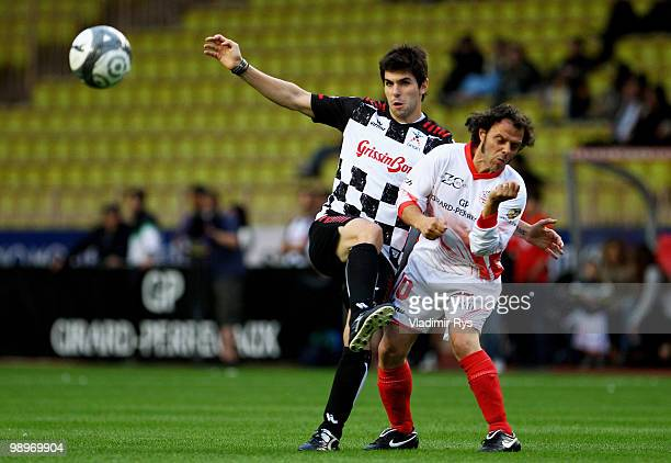 Jaime Alguersuari of Spain and Scuderia Toro Rosso and Loris Capirossi battle for the ball during the football charity match between the Monaco star...
