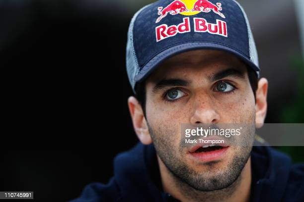 Jaime Alguersuari of Spain and Scuderia Toro Rosso is interviewed by the media in the paddock during previews to the Australian Formula One Grand...