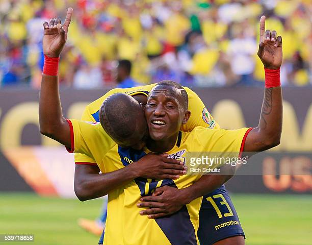 Jaime Ayovi of Ecuador celebrates with teammate Enner Valencia after scoring the second goal of his team during a group B match between Ecuador and...