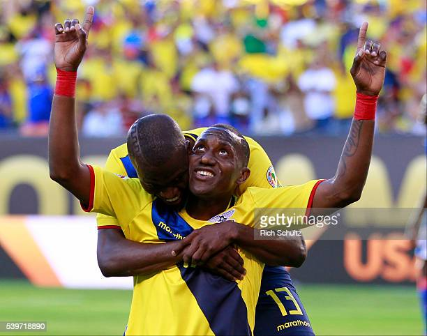 Jaime Ayovi of Ecuador celebrates with teammates Enner Valencia after scoring the second goal of his team during a group B match between Ecuador and...