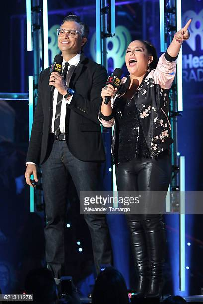 Jaime Camil and Angelica Vale speak on stage at iHeartRadio Fiesta Latina at American Airlines Arena on November 5 2016 in Miami Florida