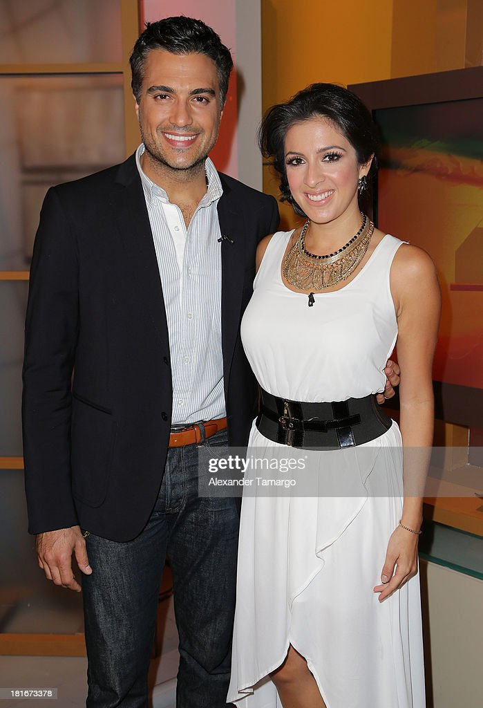 <a gi-track='captionPersonalityLinkClicked' href=/galleries/search?phrase=Jaime+Camil&family=editorial&specificpeople=580441 ng-click='$event.stopPropagation()'>Jaime Camil</a> and Maity Interiano are seen on the set of Univision's 'Despierta America' morning show at Univision Headquarters on September 23, 2013 in Miami, Florida.