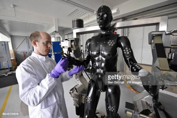 Jaime Cummins of Dstl's Chemical and Biological Physical Protection group checks the Porton Man robot mannequin that will help test the next...