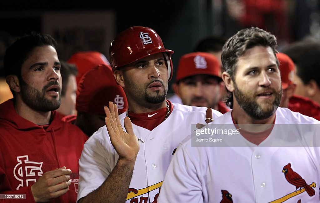 Jaime Garcia #54, <a gi-track='captionPersonalityLinkClicked' href=/galleries/search?phrase=Albert+Pujols&family=editorial&specificpeople=171151 ng-click='$event.stopPropagation()'>Albert Pujols</a> #5 and <a gi-track='captionPersonalityLinkClicked' href=/galleries/search?phrase=Lance+Berkman&family=editorial&specificpeople=167176 ng-click='$event.stopPropagation()'>Lance Berkman</a> #12 of the St. Louis Cardinals celebrate in the dugout after a two-run double by David Freese #23 in the first inning during Game Seven of the MLB World Series against the Texas Rangers at Busch Stadium on October 28, 2011 in St Louis, Missouri.