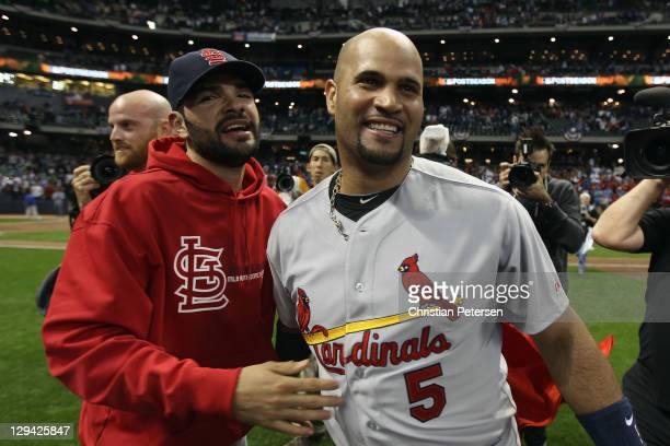 Jaime Garcia and Albert Pujols of the St Louis Cardinals celebrate on the field after they won 126 against the Milwaukee Brewers during Game Six of...