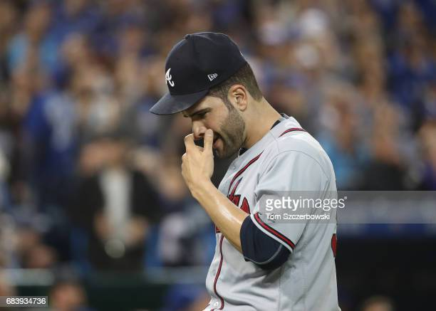 Jaime Garcia of the Atlanta Braves walks off the mound to the dugout after giving up two runs in the fourth inning during MLB game action against the...