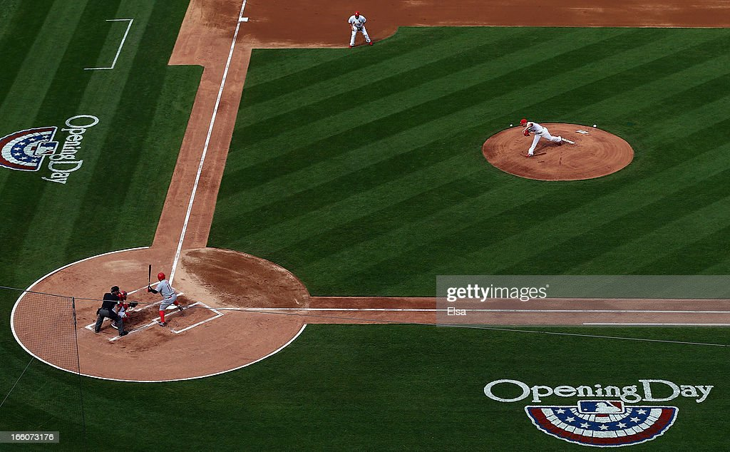Jaime Garcia #54 of the St. Louis Cardinals delivers the first pitch of the game to Shin-Soo Choo #17 of the Cincinnati Reds during Opening Day on April 8, 2013 at Busch Stadium in St. Louis, Missouri.