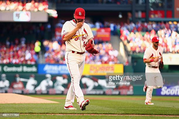 Jaime Garcia of the St Louis Cardinals returns to the dugout after the second inning against the Chicago Cubs during game two of the National League...