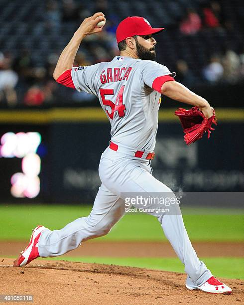 Jaime Garcia of the St Louis Cardinals throws a first inning pitch against the Atlanta Braves at Turner Field on October 2 2015 in Atlanta Georgia