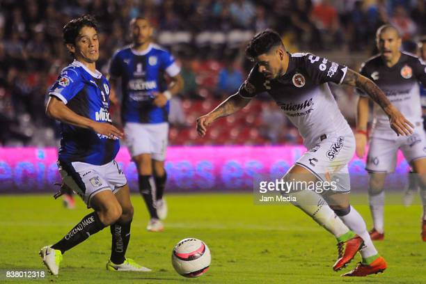 Jaime Gomez of Queretaro fights for the ball with Gustavo Bou of Tijuana during the sixth round match between Queretaro and Tijuana as part of the...