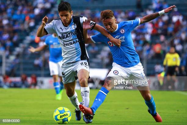 Jaime Gomez of Queretaro struggles for the ball with Martin Rodriguez of Cruz Azul during the 5th round match between Cruz Azul and Queretaro as part...