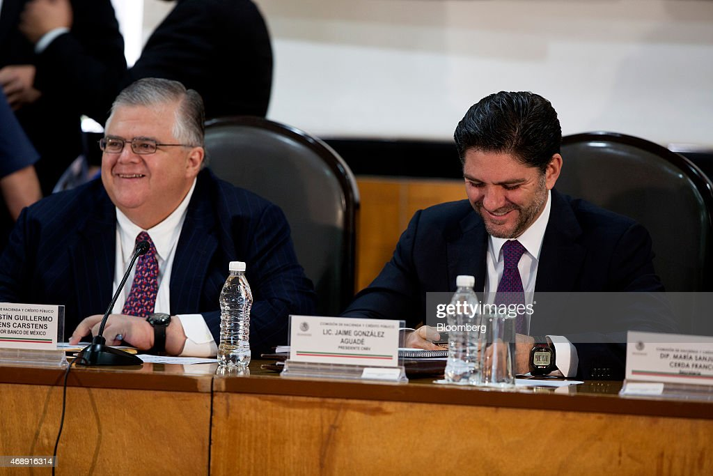Jaime Gonzalez, head of banking regulator CNBV, right, and <a gi-track='captionPersonalityLinkClicked' href=/galleries/search?phrase=Agustin+Carstens&family=editorial&specificpeople=2543899 ng-click='$event.stopPropagation()'>Agustin Carstens</a>, governor of Banco de Mexico, smile while testifying to the finance committee of the lower house of Mexico's Congress in Mexico City, Mexico, on Wednesday, April 8, 2015. An overhaul of lending regulations has lowered processing costs for credit-card transactions, helping promote acceptance for purchases at smaller amounts and at more businesses, Carstens told the committee. Photographer: Susana Gonzalez/Bloomberg via Getty Images