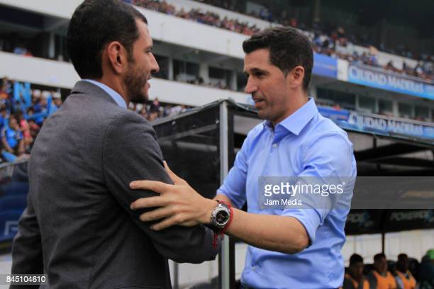 Jaime Lozano Coach of Queretaro greets Gustavo Diaz Coach of Leon prior to the 8th round match between Queretaro and Leon as part of the Torneo...
