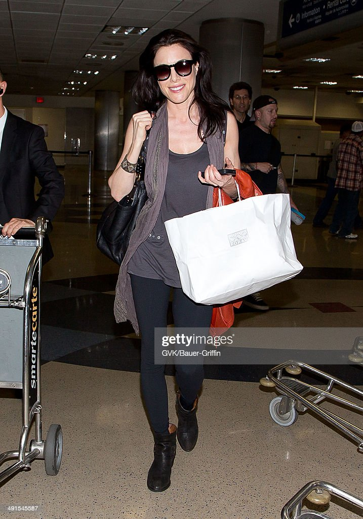 <a gi-track='captionPersonalityLinkClicked' href=/galleries/search?phrase=Jaime+Murray+-+Actress&family=editorial&specificpeople=217455 ng-click='$event.stopPropagation()'>Jaime Murray</a> seen at LAX on May 16, 2014 in Los Angeles, California.