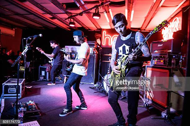 Jaime Preciado Tony Perry Mike Fuentes and Vic Fuentes of Pierce The Veil performs at HMV 363 Oxford Street on April 27 2016 in London England