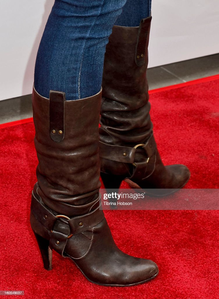 <a gi-track='captionPersonalityLinkClicked' href=/galleries/search?phrase=Jaime+Pressly&family=editorial&specificpeople=211226 ng-click='$event.stopPropagation()'>Jaime Pressly</a> (shoe detail) attends Stan Lee's 'Kids Universe' book label launch at Giggles 'N' Hugs on February 2, 2013 in Century City, California.