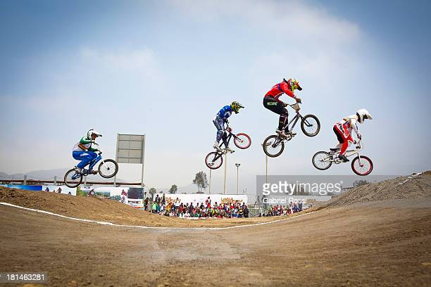 Jaime Quintanilla of Bolivia Facundo Rosas of Argentina Cristobal Palominos of Chile and Juan Carlos Diaz of Colombia compete during the BMX Men...