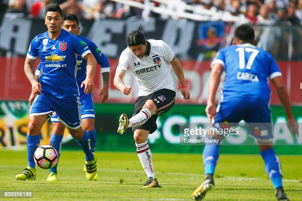 Jaime Valdes of Colo Colo kicks the ball to score the second goal of his team during a match between ColoColo and U de Chile as part of Torneo...
