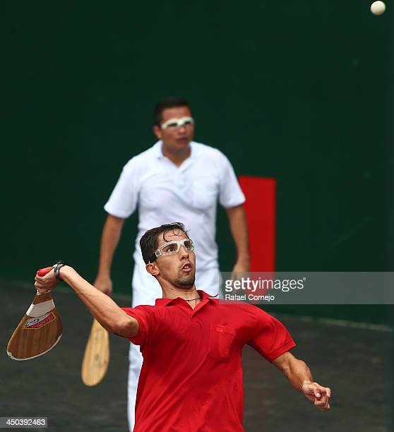 Jaime Vera of Venezuela and Oliver Lopez of El Salvador compete during the Basque Pelota event as part of the XVII Bolivarian Games Trujillo 2013 at...