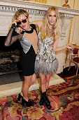 Jaime Winstone and Mary Charteris pose backstage at the Julien Macdonald show during London Fashion Week Fall/Winter 2013/14 at Goldsmiths' Hall on...