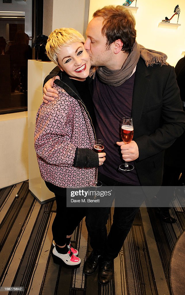 Jaime Winstone (L) and Nicholas Kirkwood attend a Christmas drinks hosted by designer Nicholas Kirkwood to celebrate his partnership with Chambord black raspberry liquer, and launch the limited edition shoe 'The Chambord' at the Nicholas Kirkwood Mount Street store on December 12, 2012 in London, England.